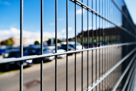 Close up Metal grille or fence of car parking. Security concept.