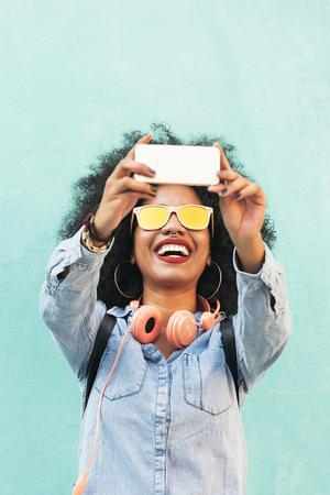 Self portrait of beautiful young afro american woman. Selfie Concept. Standard-Bild