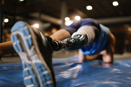 Disabled young man training in the gym. Disabled sportsman Concept. Stok Fotoğraf