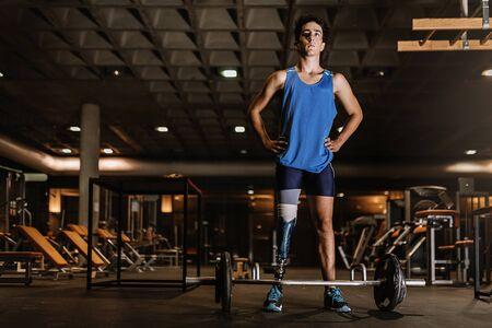 Portrait of disabled young in the gym. Disabled sportsman Concept. Reklamní fotografie