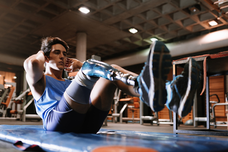 Disabled young man training in the gym. Disabled sportsman Concept. Stockfoto