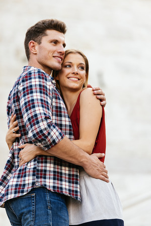 Young loving couple hugging in the street. Young Love Concept. Stock Photo