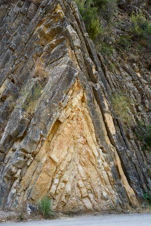 different rock strata on the mountain Stock Photo