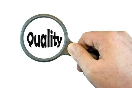 hand held: Hand Held Magnifying Glass over the word Quality