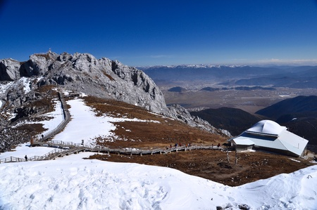 top view of the high mountain covering with snow photo