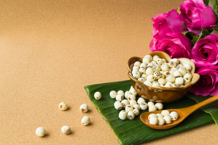 cork wood: Lotus seed in ceramics cup on banana leaf, cork wood texture background Stock Photo