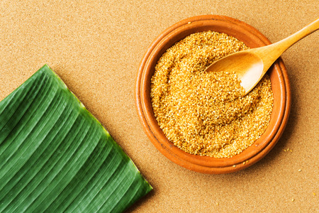 cork wood: White sesame seeds in earthenware, banana leaf, cork wood texture background, one of the ingredients of Asia food and sweet dessert