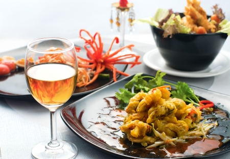 sea food: Dinner with Thai Food : Fried Sea Mussel and Spicy Papaya Salad serve with thai wine Stock Photo