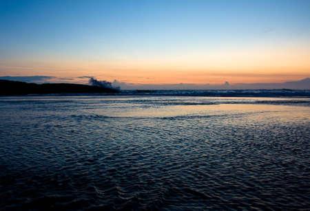 kovalam: Strong waves at sunset hitting the small island near the shore at Kovalam beach, Kerala, India Stock Photo
