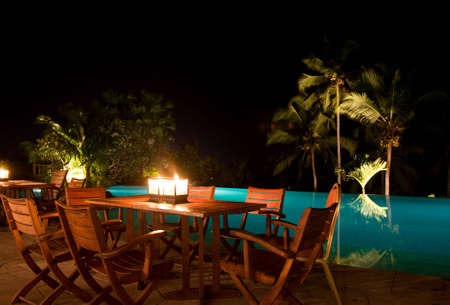 poolside: poolside candle light dinner at the resort Stock Photo