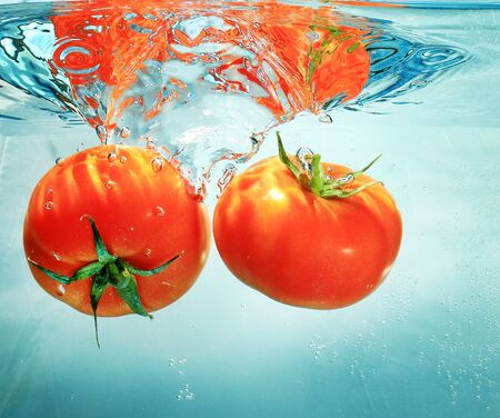 repulse: tomatoes in water on a blue background