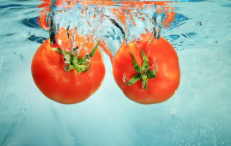 profound: tomatoes in water on a blue background