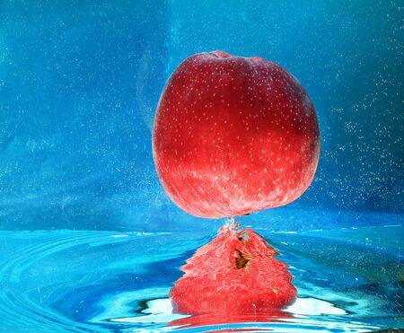 regimen: apple in water on a blue background