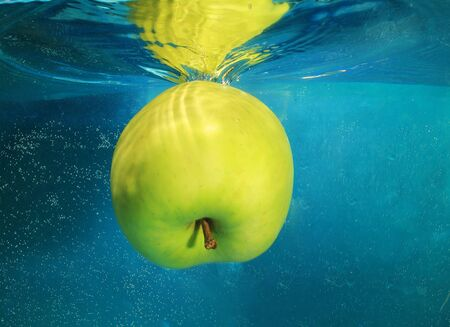 profound: apple in water on a blue background