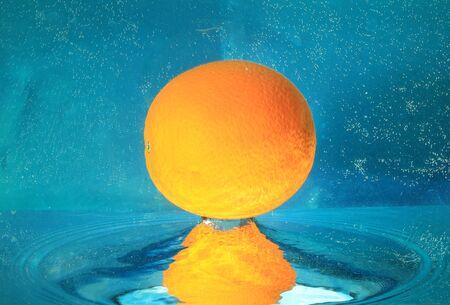 sputter: orange in water on a blue background