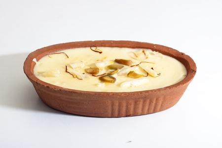 Indian sweet Firni in oval earthen bowl photo
