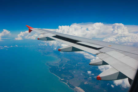 air transport: Aircraft wing on the clouds, flying background