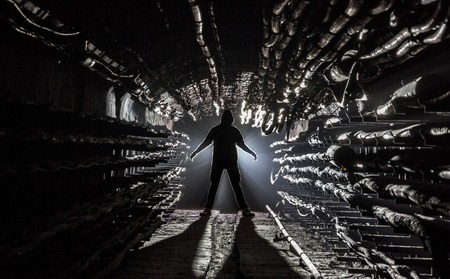 enters: Young man enters the subway tunnel