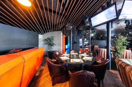 shakti: MOSCOW - JULY 2013: Interior of a modern restaurant SHAKTI TERRACE in the center of Moscow. The orange bar in the dance hall