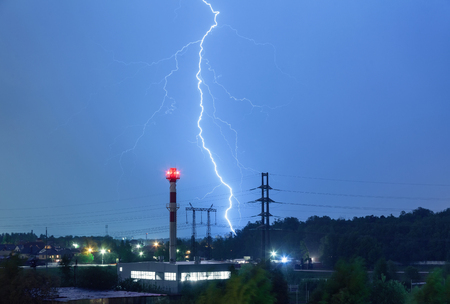 boiler house: Lightning in the night sky over the boiler house and power lines