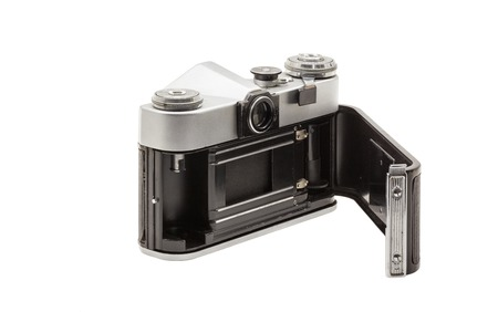 soviet: Retro soviet film camera isolated on white background. Soviet reflex camera. Opened back side Stock Photo