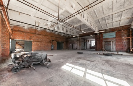 industrial building: Abandoned, empty room of an industrial building Stock Photo