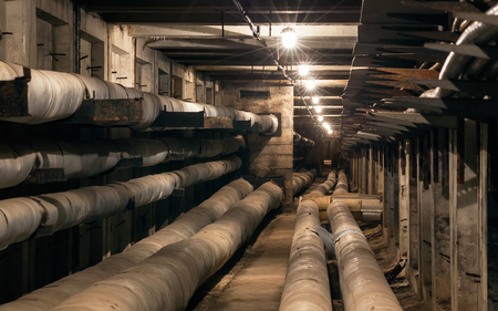 lagging: Tunnel for underground heating mains and electric cables Stock Photo