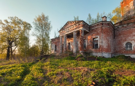 portico: Portico with columns of an old, abandoned, brick church at sunset