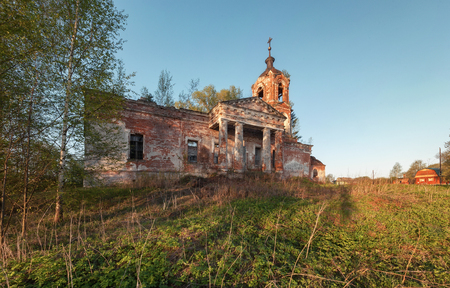 portico: Abandoned brick orthodox church with a portico and columns at sunset Stock Photo