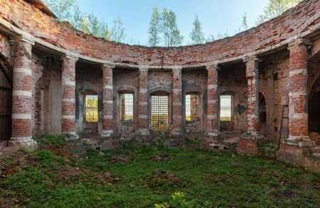 rotunda: Ancient rotunda with columns without a dome. Abandoned brick temple overgrown with grass Stock Photo