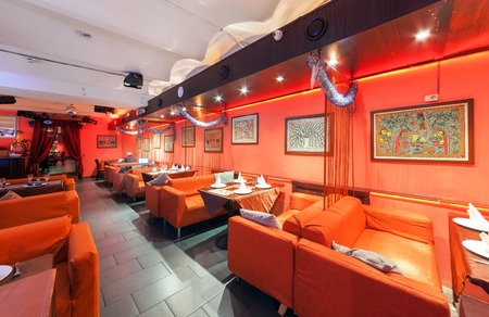 sutra: MOSCOWRUSSIA - DECEMBER 2014. Interior Indian modern art cafe SUTRA. Orange room