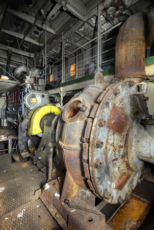 diesel generator: Ship hold with diesel engine mounted on ship. Engine room on a old cargo boat ship. Stock Photo