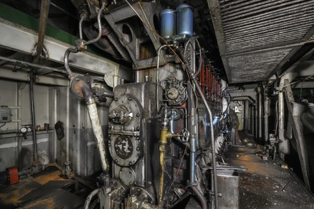 engine room: Ship hold with diesel engine mounted on ship. Engine room on a old cargo boat ship. Stock Photo