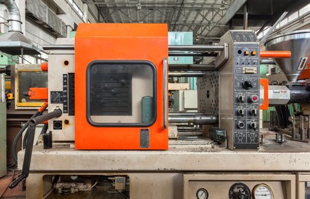 Injection molding thermoplastic machine close up Stockfoto