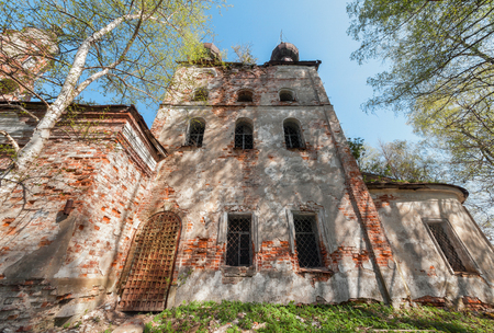 front elevation: Quadrangle abandoned russian temple with old iron gates and windows Stock Photo
