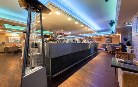 mediterranean interior: MOSCOW - JULY 2014: Interior of stylish Mediterranean cuisine Italian restaurant - SILLYCAT. Restaurant room with a bar lined with metal in the middle Editorial