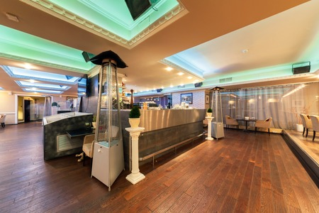 mediterranean interior: MOSCOW - JULY 2014: Interior of stylish Mediterranean cuisine Italian restaurant - SILLYCAT. Restaurant room with a bar in the middle Editorial