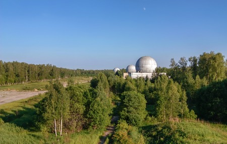bugging: Russian military base in the forest with several big domes of a radar antenna Stock Photo