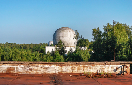 Old big dome of a radar antenna of a Russian military base Stock Photo