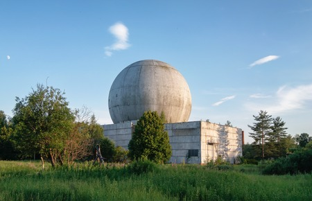 bugging: Old big dome of a radar antenna on the roof of the building of a Russian military base