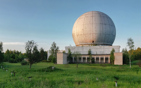 Old giant dome of a radar antenna of a Russian military base