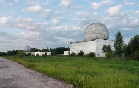 Russian military base in the forest with several big domes of a radar antenna Stock Photo