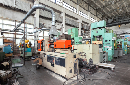 Injection molding plastic machine and hydraulic press Stok Fotoğraf - 67752383