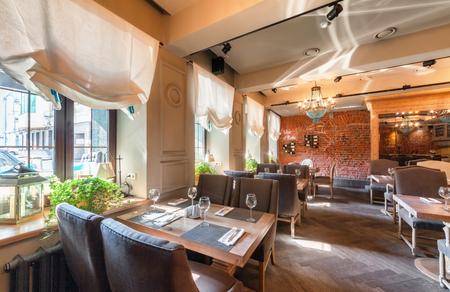 MOSCOW - AUGUST 2014: Interior elegant city restaurant RULET in loft style. Tables near the windows Editöryel