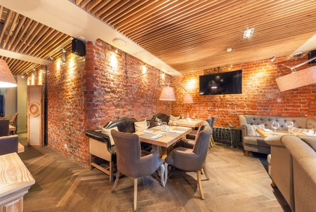 MOSCOW - AUGUST 2014: Interior elegant city restaurant RULET in loft style. Table near the brick wall