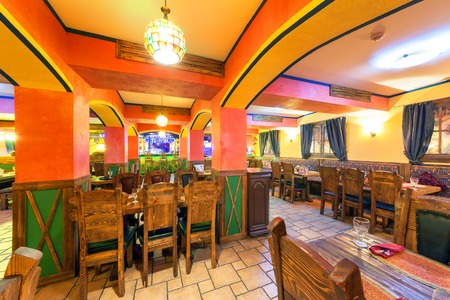 MOSCOW - AUGUST 2014: Interior of the Mexican nightclub restaurant SOMBRERO. Hall with a restaurant with wooden furniture Editorial