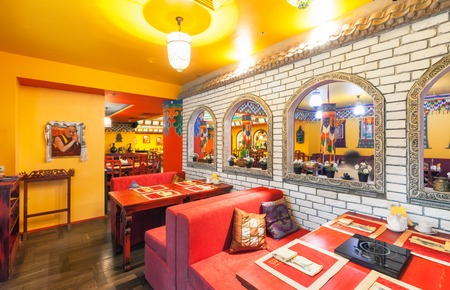 MOSCOW - AUGUST 2014: The interior of the restaurant Indian and Tibetan cuisine and is decorated in ethnic style Editorial