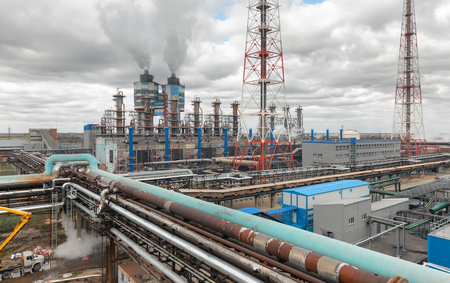 destilacion: Chemical plant for production of ammonia and nitrogen fertilization on day time. The pipeline connecting the plants workshops