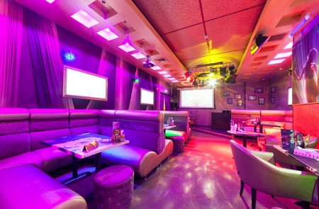 MOSCOW - AUGUST 2014: Modern interior of the main hall of the restaurant-karaoke BRUSOFF. Table with high sofa Editorial