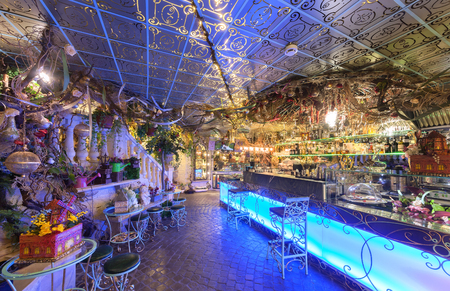 MOSCOW - AUGUST 2014: Vintage interior of the restaurant of French cuisine Chateau de Fleurs. Bar counter with blue lighting and wrought iron bar stools